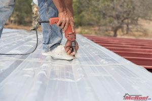 Man Installing a Corrugated Metal Roof