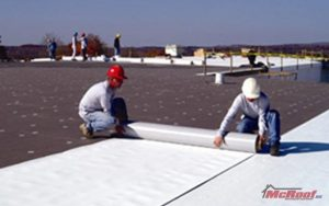 Workers Completing PVC Roof Installation