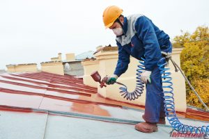 Working Applying Polyurea Roof Coatings