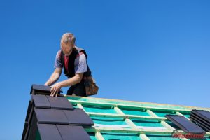 Roofer Installing Synthetic Shingles