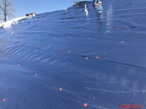 Tarping the Roof as Part of Emergency Roof Repair